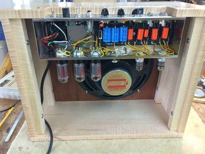 Photos from the amp building workshop We build a Fender Tweed deluxe with a flame maple cabinet. The hand wiring was a b...